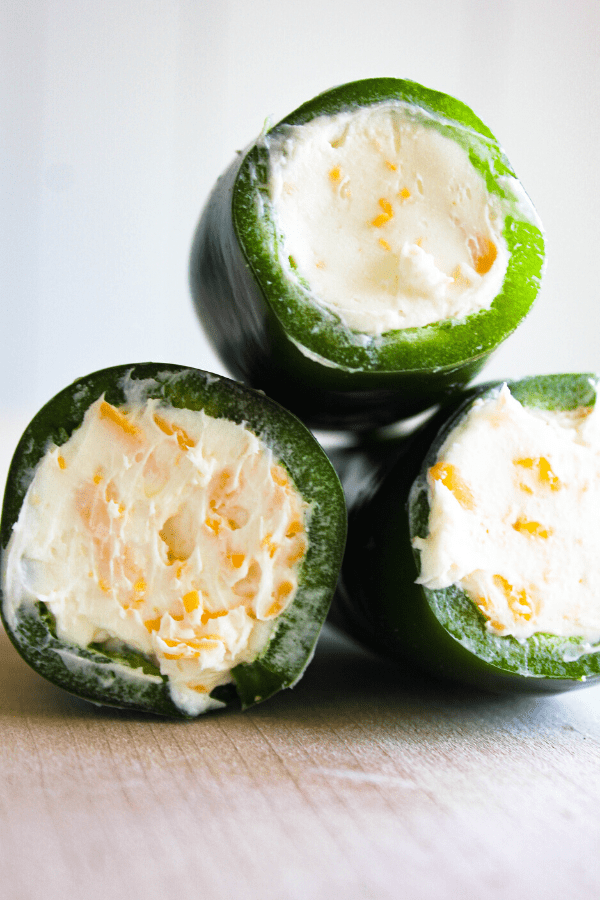 Stack whole jalapenos stuffed with cream cheese mixture.