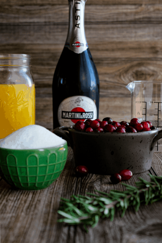 Ingredients for cranberry orange mimosa with rosemary (see recipe card).