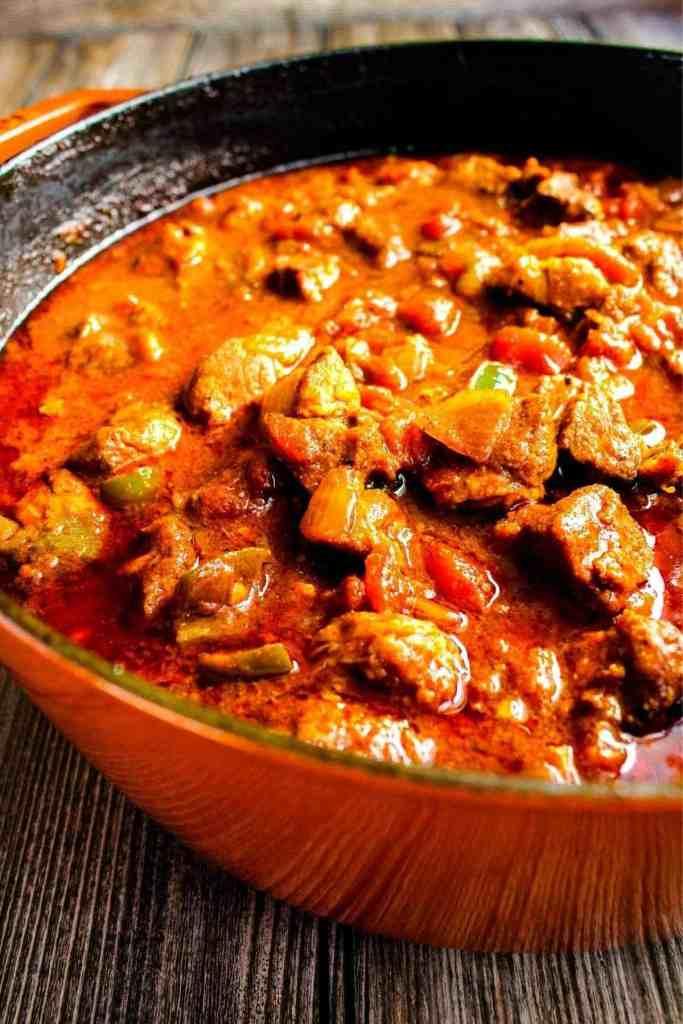 Spicy pork chili in Dutch oven.