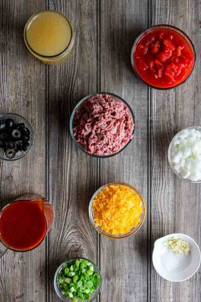Top down shot of ingredients for beef enchilada soup (see recipe card).