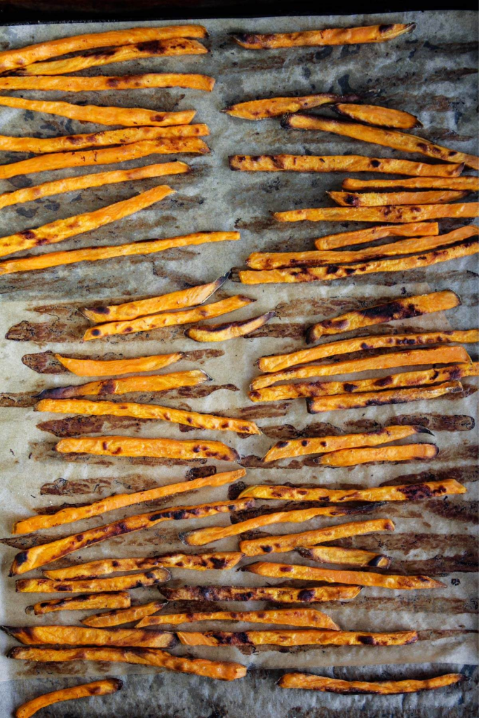 Baked fries on a sheet pan.