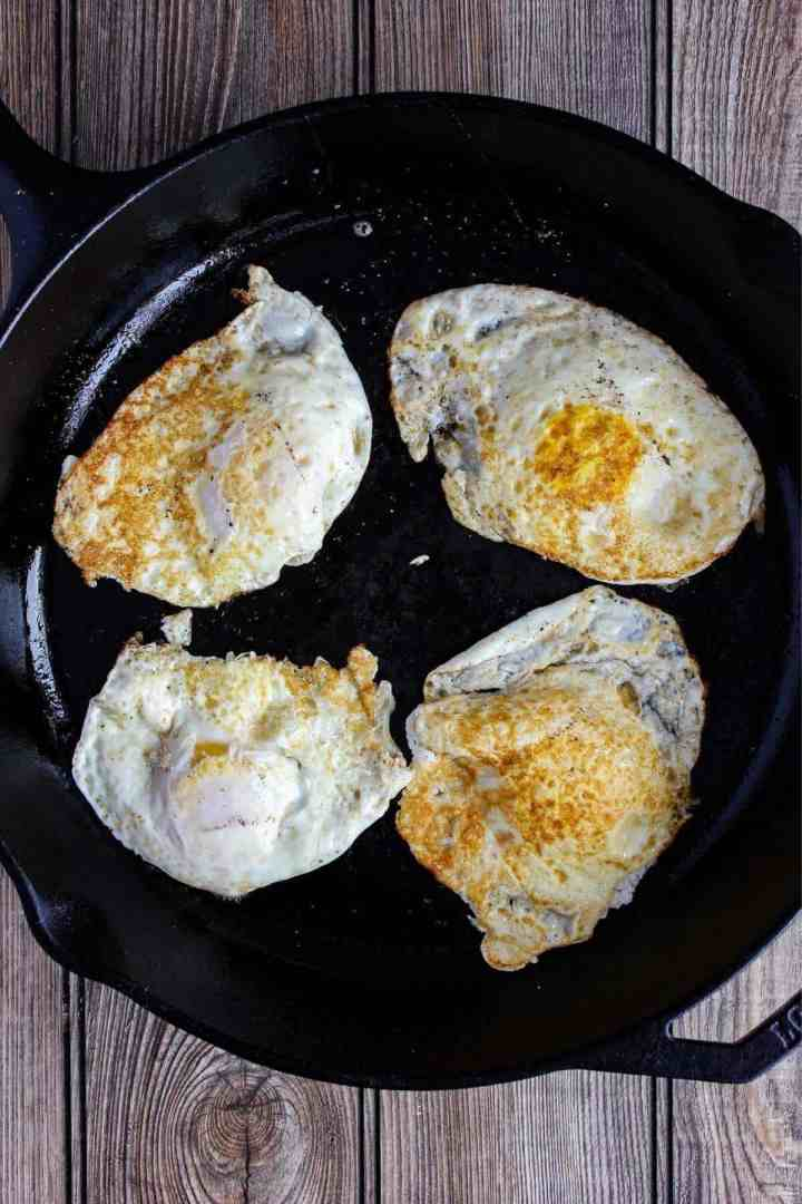 Fried eggs in a skillet.
