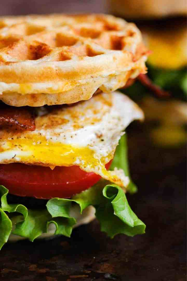 Close up of breakfast waffle sandwich.