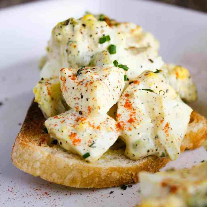 Close-up of deviled egg toast.