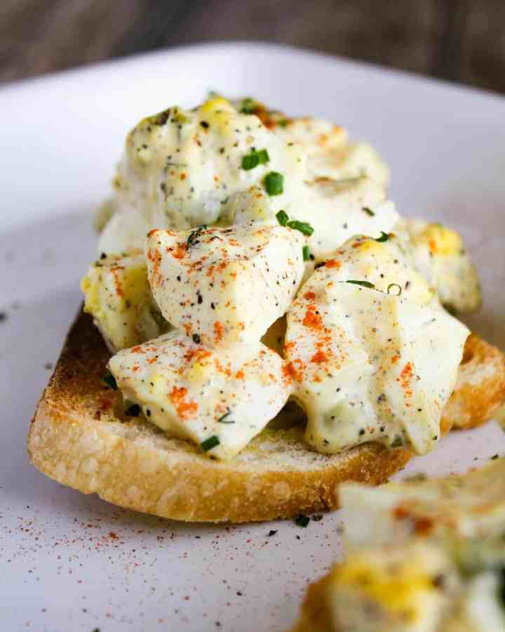 Close-up of deviled egg toast.