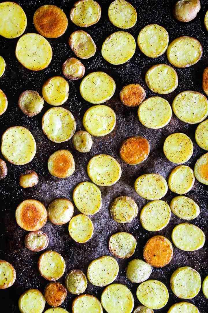 Roasted potatoes on a sheet pan.