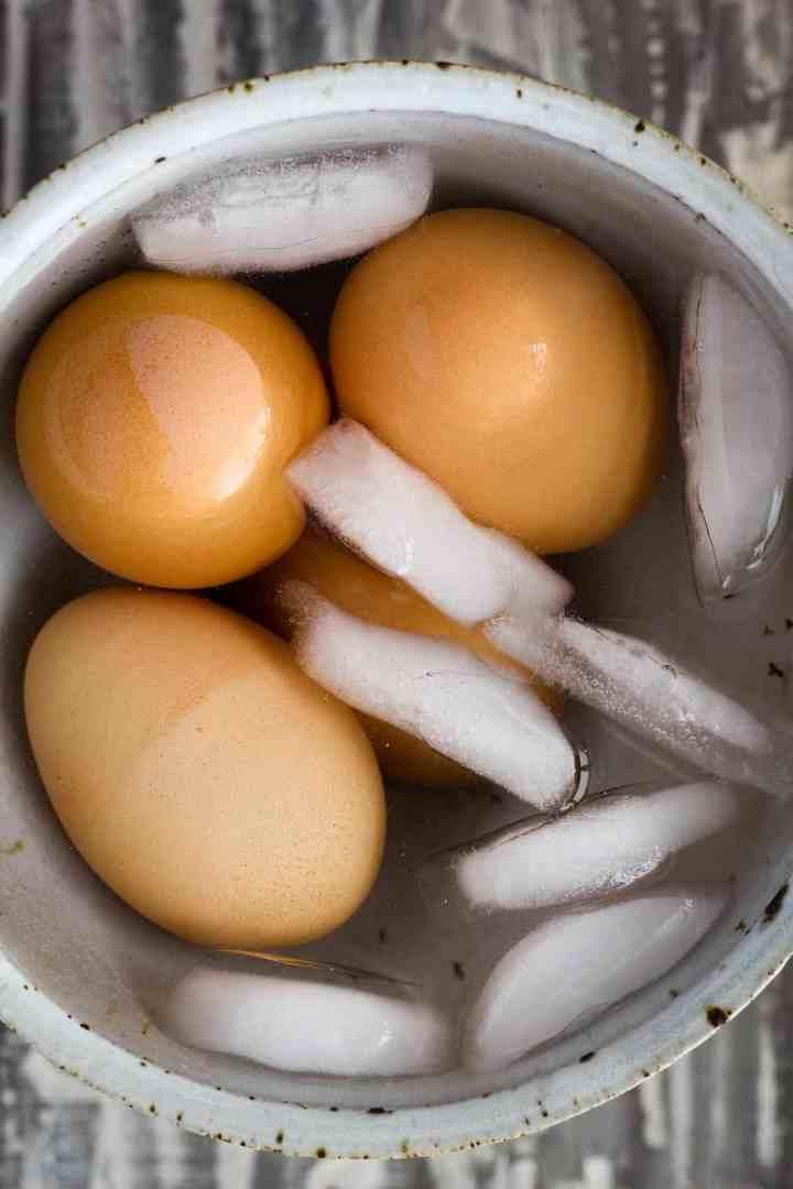 Boiled eggs in ice bath.