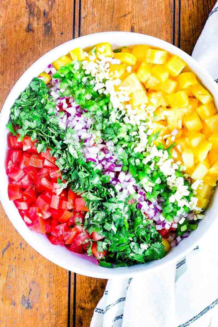 Ingredients for pineapple salsa in a bowl.