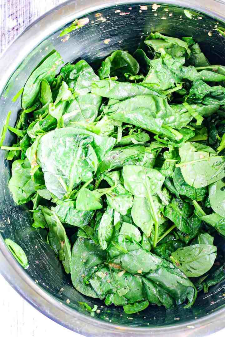 Spinach dressed in vinaigrette.