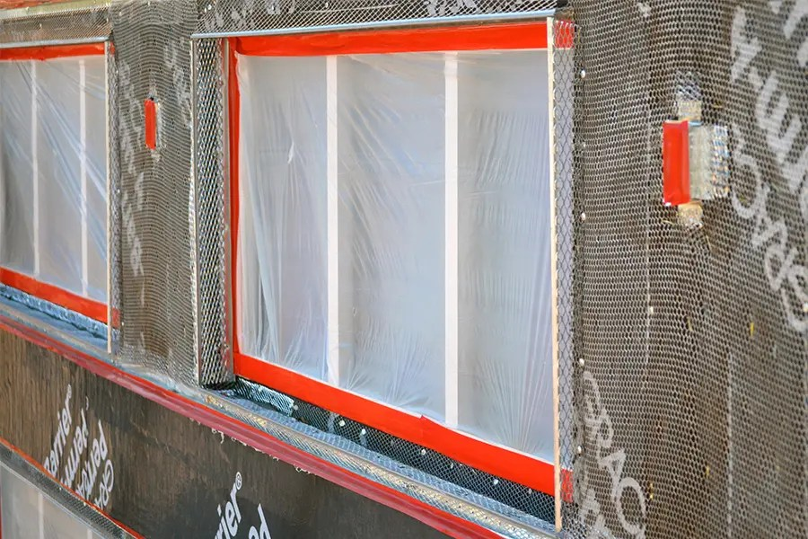 Red stucco masking tape application