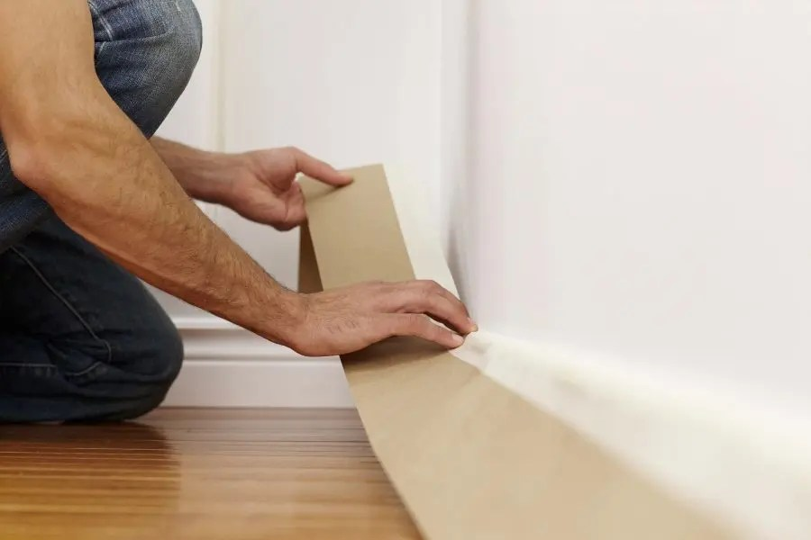 Masking tape on baseboard