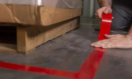 How is floor marking tape used to promote safety?