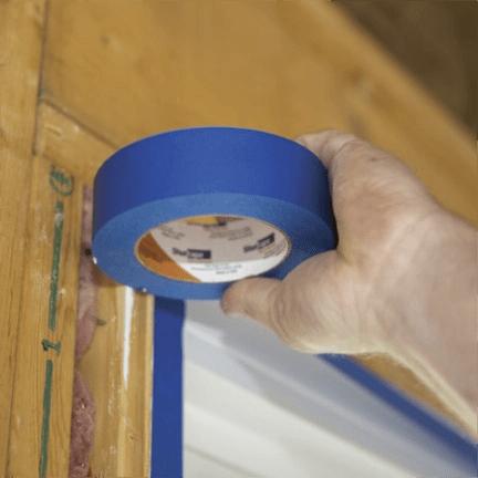 applying blue painter's tape