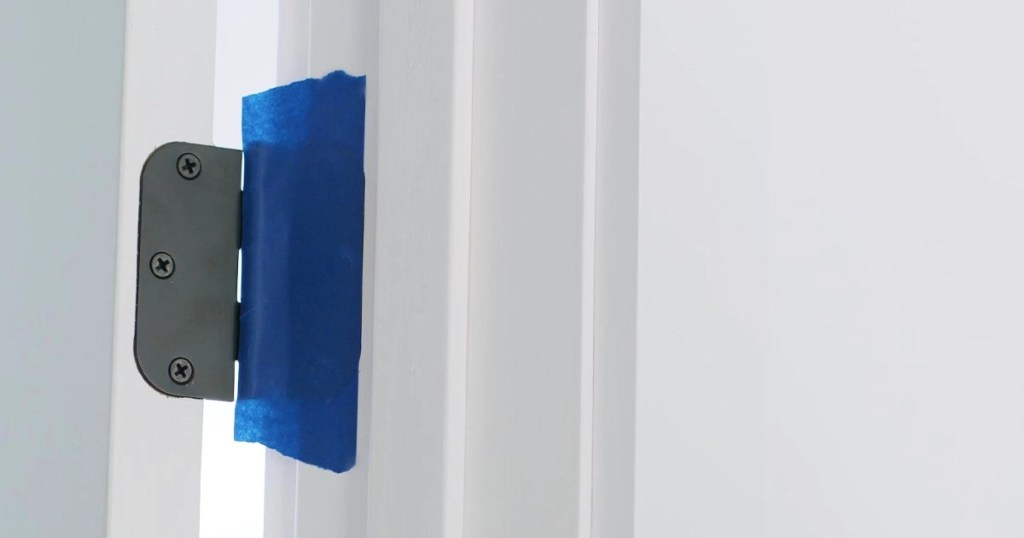Masking tape on door hardware