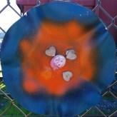 Flower sculpture with orange center