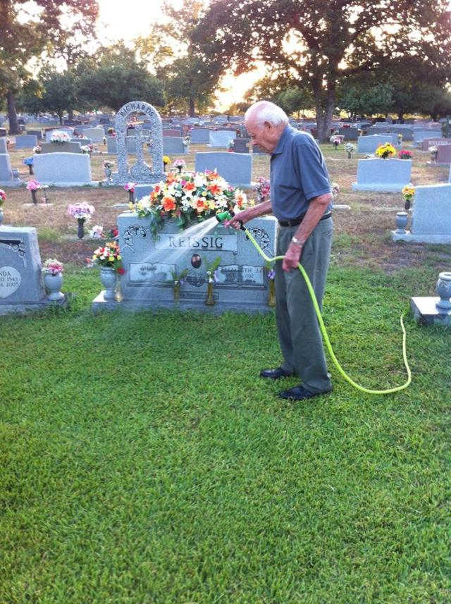 Roger Reissig Waters The Grass At His Wife's Grave