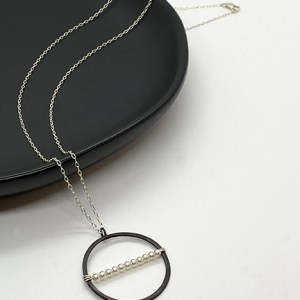 Black silver circle pendant necklace