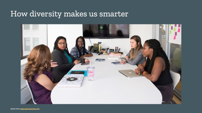 5 women of colour sitting around a meeting room table