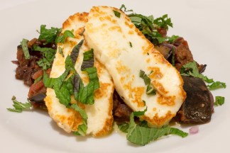 Aubergine stew with halloumi, pine nuts and herbs