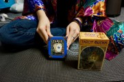 Alicia Simpson, 20, holding up her first set of tarot cards alongside her new set in her dorm room at Flagler College in St. Augustine, Florida on Wednesday, April 12, 2017. As Simpson began to become more interested in paganism, she wanted to expand her collection of tarot cards.