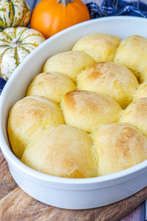 Pumpkin Yeast Rolls in a white pan