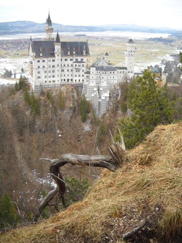 View of Schloss Neuschwanstein from a cliff in Bavaria.