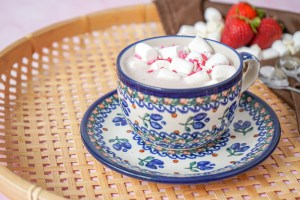 Strawberry White Hot Chocolate in a blue ceramic teacup.
