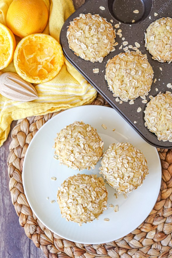 Orange Oat Muffins in a pan and on a plate
