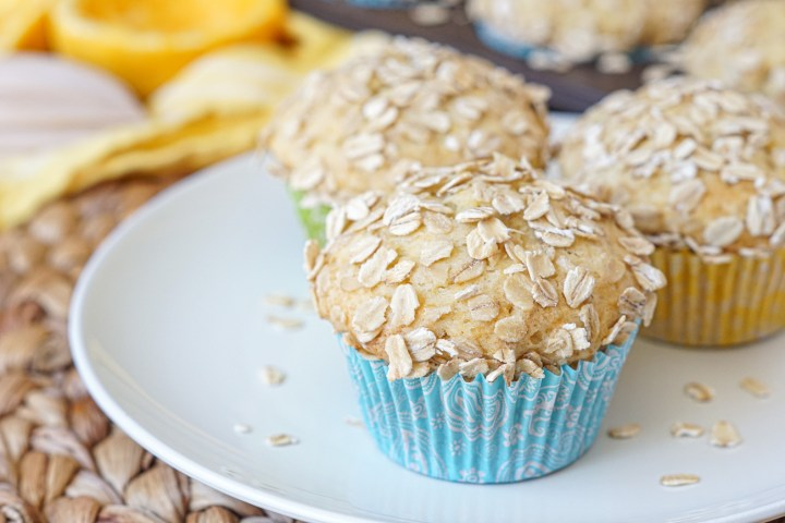 Orange Oat Muffins covered in oats