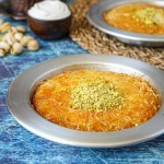 Künefe (Turkish Sweet Cheese Pastry) in two metal pans.