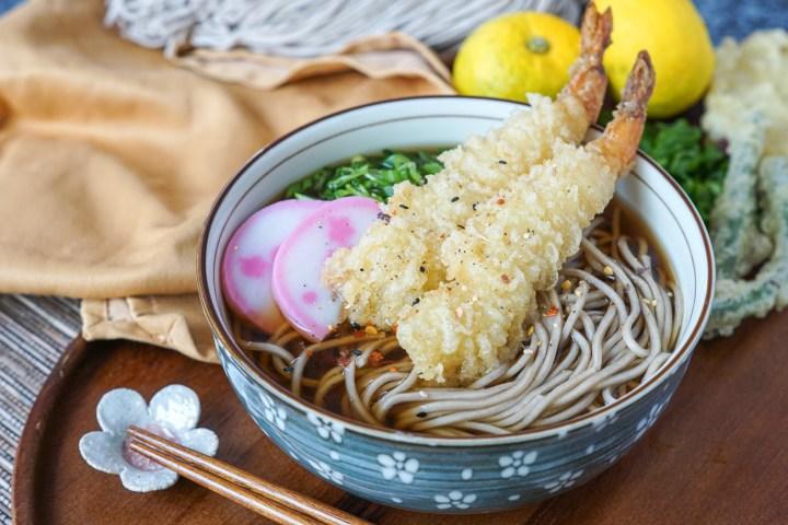 Toshikoshi Soba (Japanese New Year Soba) topped with tempura, green onions, and kamaboko