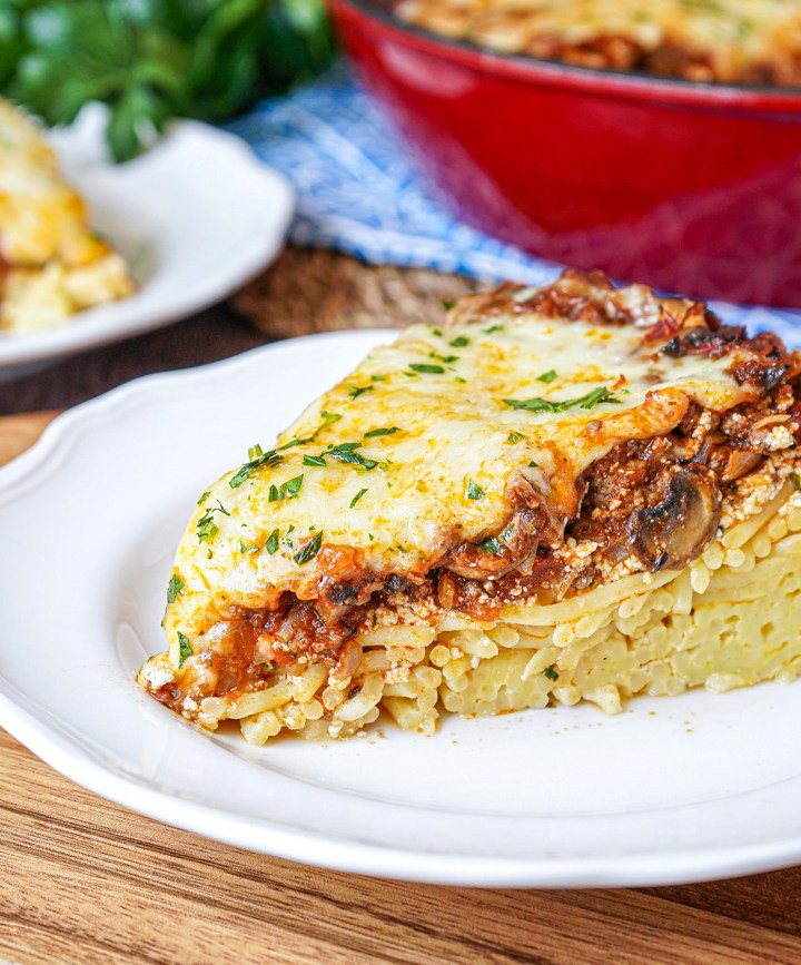 Slice of Spaghetti Pie on a white plate.