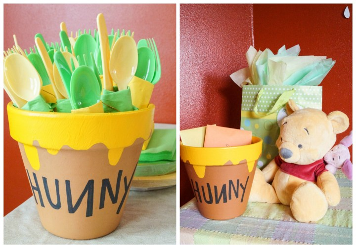 """Clay pots painted with dripping yellow paint on the top and word """"Hunny"""" in black marker."""