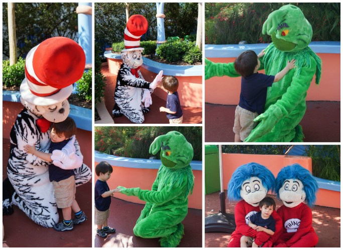 Boy hugging Cat in the Hat, the Grinch, and Thing 1 and Thing 2.