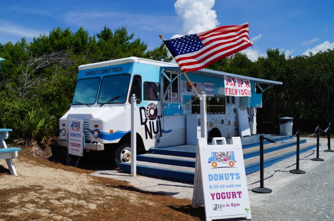 Charlie's Donut Truck with a large American flag in Alys Beach.
