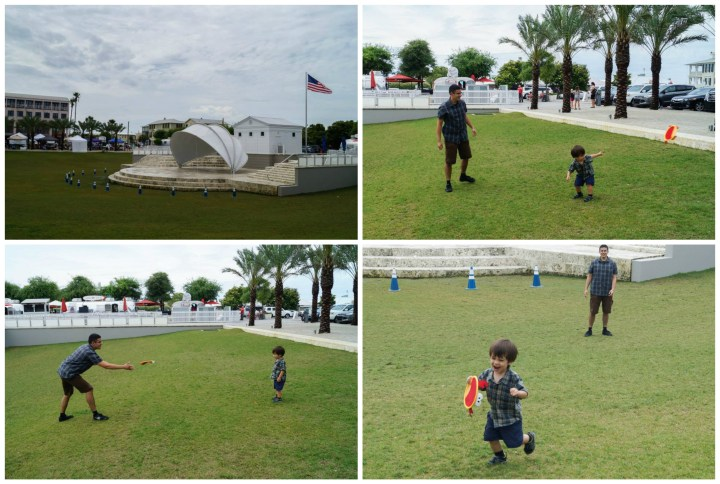 Playing frisbee on a large field in the center of Seaside.
