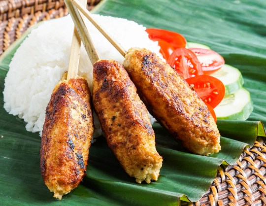 Three pieces of Sate Lilit Ayam (Balinese Chicken Satay)