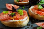 Crisp Toasted Bagel with Fromage Blanc, Tomato, Sea Salt, and Basil.