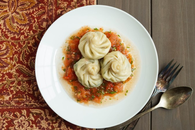 Tarkari Momo (Nepalese Vegetable and Cheese Dumplings) on a plate