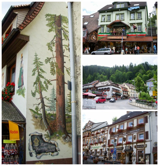Buildings in Triberg with paintings on the side of trees and flower boxes in the windows