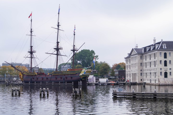 Het Scheepvaartmuseum (National Maritime Museum) with a large ship on the water