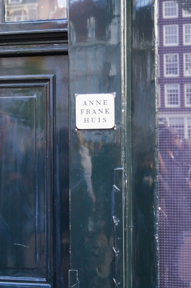 Green door with a sign for Anne Frank Huis (Anne Frank House)