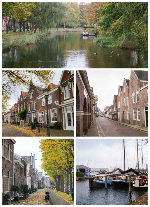Creek in Muiden with ducks and brown buildings lining the street.
