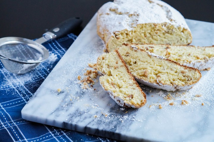Quarkstollen topped with powdered sugar and sliced