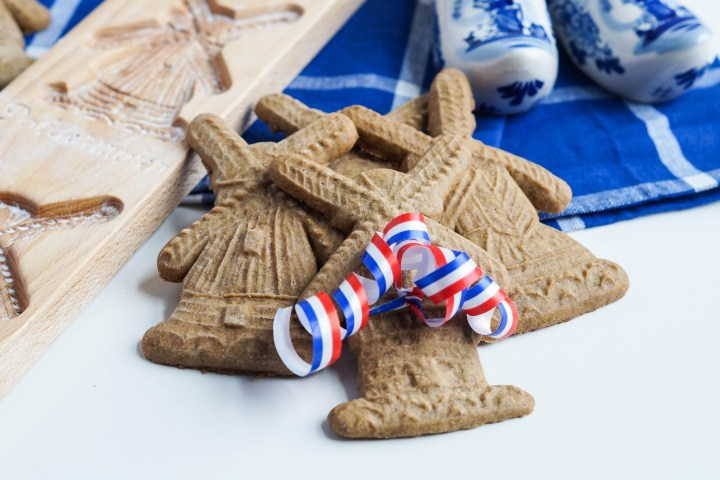 Speculaas (Dutch Spiced Cookies) with a red, blue, and white ribbon.