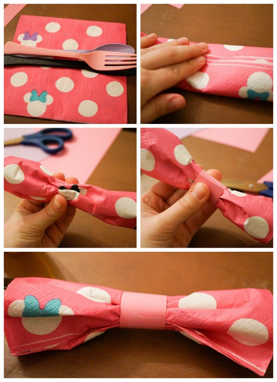 Wrapping silverware in Minnie Mouse napkins and folding into a bow.