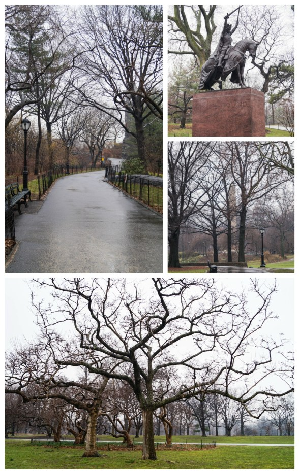 Sidewalk in Central Park with bare trees and a statue of knight on horse.
