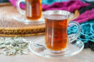 Shay bil Maramiya (Sage-Scented Tea) in two glasses.