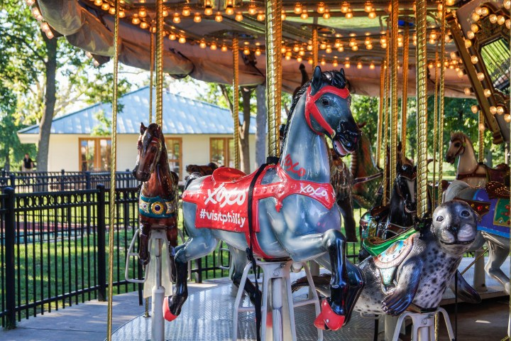 Gray horse with XOXO #VisitPhilly sign on side on the Parx Liberty Carousel.