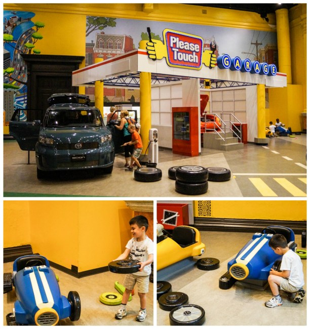 Putting tires on a car at the Roadside Attractions exhibit in the Please Touch Museum.
